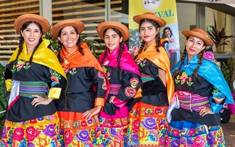 Women dressed in traditional clothes at the Etnia Latina Festival