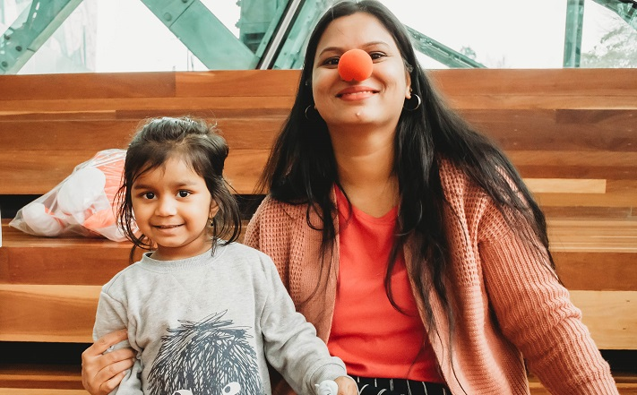 Mother and daughter with red nose